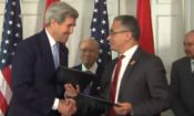 Kerry Marzouk signing the memorandum of understanding